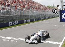 <p>BMW Sauber driver Robert Kubica of Poland wins the Canadian F1 Grand Prix in Montreal June 8, 2008. REUTERS/Chris Wattie</p>