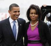 <p>Barack Obama e sua mulher, Michelle Obama, pouco antes de saberem que ele havia conquistado o número de delegados suficiente para a indicação do partido democrata. Photo by Jason Reed</p>