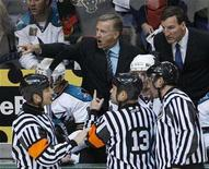 <p>Former San Jose Sharks coach Ron Wilson (C) argues with officials during the second overtime period against the Dallas Stars in Game 6 of their NHL Western Conference semi-final hockey game in Dallas, Texas in this May 4, 2008 file photo. The National Hockey League's Toronto Maple Leafs dipped into the past on Tuesday and named former player Ron Wilson as head coach of the team, which is coming off the latest of a string of disappointing seasons. REUTERS/Jessica Rinaldi</p>