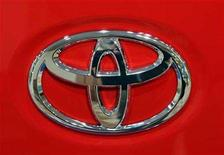 <p>The Toyota Motors logo is seen on a car at a Toyota showroom in Tokyo November 7, 2006. REUTERS/Toshiyuki Aizawa</p>
