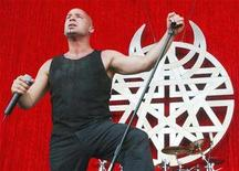 "<p>David Draiman, the lead singer in the Heavy Metal rock group Disturbed, performs at Ozzfest 2003 in Devore, California, late July 5, 2003. Hard-rock band Disturbed claims its third Billboard 200 No. 1 with ""Indestructible,"" which bowed atop the album chart Wednesday. REUTERS/Jim Ruymen</p>"