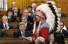 <p>Canada's Prime Minister Stephen Harper (bottom L) and other MP's listen as National Chief of the Assembly of First Nations Phil Fontaine (R) speaks in the House of Commons on Parliament Hill in Ottawa June 11, 2008. REUTERS/Chris Wattie</p>