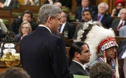 <p>Canadian Prime Minister Stephen Harper issues an apology to aboriginals in the House of Commons on Parliament Hill in Ottawa June 11, 2008. REUTERS/Chris Wattie</p>