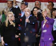 <p>Republican presidential candidate U.S. Senator John McCain (R-AZ) greets supporters next to his wife Cindy (R) and his daughter Meghan (L) during a rally at Orlando's airport, Florida January 28, 2008. REUTERS/Carlos Barria</p>
