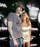"<p>Tommy Lee and Pamela Anderson arrive at the opening party of the rock-inspired bar and dining lounge ""ROKBAR"" in Hollywood in this June 30, 2005 file photo. REUTERS/Mario Anzuoni</p>"
