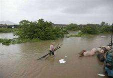 <p>Un campo allagato da un fiume che è straripato nella provincia del Guangdong. REUTERS/China Daily</p>