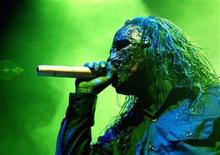 "<p>Cori #8, singer of U.S. death metal rock band Slipknot, performs during a concert in Caracas September 20, 2005. Picture taken September 20, 2005. Slipknot's fourth album has been christened ""All Hope Is Gone"" and will arrive August 26. REUTERS/Howard Yanes</p>"