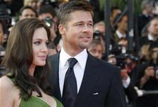 "<p>Angelina Jolie (L) and Brad Pitt arrive for the screening of the animated film ""Kung Fu Panda"" by directors Mark Osborne and John Stevenson at the 61st Cannes Film Festival May 15, 2008. The new game in Correns, a village in Provence suddenly hit by media frenzy since Pitt and Jolie moved into a nearby villa, is to make up stories about the couple for the paparazzi. REUTERS/Vincent Kessler</p>"