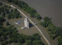 <p>An aerial photograph shows flooded grain terminal near Burlington, Iowa, June 18, 2008. The swollen Mississippi River ran over the top of at least 12 more levees on Wednesday, as floodwaters swallowed up more U.S. farmland, adding to billion-dollar losses and feeding global food inflation fears. Photo by Ron Mayland</p>