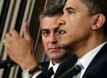 <p>Academy awarding-winning actor George Clooney (L) looks on as Senator Barack Obama (D-IL) speaks about the Darfur region of Sudan, in Washington April 27, 2006. REUTERS/Jason Reed</p>
