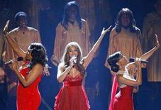 <p>The cast of 'Dreamgirls' Jennifer Hudson (L), Beyonce Knowles (C) and Anika Noni Rose perform at the 79th Annual Academy Awards in Hollywood, California, February 25, 2007. REUTERS/Gary Hershorn</p>
