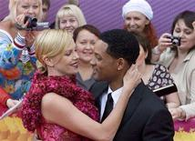 <p>U.S. actor Will Smith (R) and South African actress Charlize Theron arrive for the opening of the Moscow Film festival where they are promoting their movie 'Hancock' in Moscow June 19, 2008. REUTERS/Sergei Karpukhin</p>