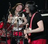 <p>Meg White (L) and Jack White of The White Stripes perform during the band's set on the second night of the annual KROQ Almost Acoustic Christmas concert at the Gibson Amphitheatre in Los Angeles December 11, 2005. REUTERS/Chris Pizzello</p>