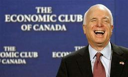 <p>Presumptive Republican presidential candidate Senator John McCain laughs before delivering a speech to the Economic Club of Canada in Ottawa June 20, 2008. REUTERS/Chris Wattie</p>