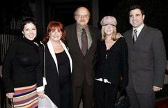 "<p>Cast member Dennis Franz (C) arrives with members of his family for the final wrap party of the ABC television series ""NYPD Blue"" in Los Angeles February 12, 2005. REUTERS/Robert Galbraith</p>"