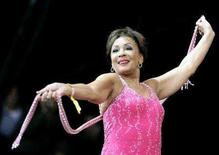 <p>Singer Dame Shirley Bassey performs during the Glastonbury music festival in Somerset, June 24, 2007. REUTERS/Dylan Martinez</p>