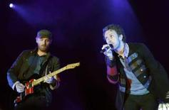 "<p>File picture shows Chris Martin (R) and Jonny Buckland of Coldplay perform during a concert, part of the ""Viva la vida"" tour, in Barcelona June 17, 2008. REUTERS/Albert Gea</p>"