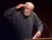 <p>Comedian George Carlin salutes his audience at the historic Wheeler Opera House in Aspen, Colorado, in this March 2, 2002 file photo. REUTERS/Gary C. Caskey/Files</p>