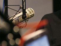 <p>A microphone is seen in a studio booth during a radio interview. REUTERS/Danny Moloshok</p>