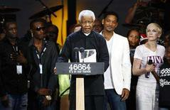 <p>Former South African President Nelson Mandela speaks during the 46664 concert in his honor in Hyde Park, London June 27, 2008. REUTERS/Andrew Winning</p>