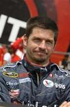 <p>Canadian race car driver Patrick Carpentier poses for a picture before the NASCAR Sprint Cup Pocono 500 at Pocono Raceway in Long Pond, Pennsylvania June 8, 2008. REUTERS /Robert LeSieur</p>
