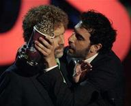 <p>Winners of the best movie kiss, Will Ferrell (L) and Sacha Baron Cohen in 'Talladega Nights', prepare to kiss at the 2007 MTV Movie Awards in Los Angeles, California in this file photo from June 3, 2007. REUTERS/Fred Prouser</p>