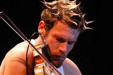 <p>Ashley MacIssac plays the fiddle in an undated handout photo. REUTERS/Paquin Entertainment/Handout</p>