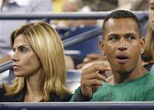 <p>New York Yankees third baseman Alex Rodriguez (R) watches an evening tennis match with his wife Cynthia at the U.S. Open in Flushing Meadows, New York, September 1, 2007. REUTERS/Ray Stubblebine</p>