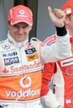 <p>Kovalainen é o pole do GP da Inglaterra; Massa larga em nono. Heikki Kovalainen, da McLaren, conquistou sua primeira pole position na Fórmula 1, neste sábado, no treino classificatório para o GP da Inglaterra. 5 de julho. Photo by Thomas Bohlen</p>