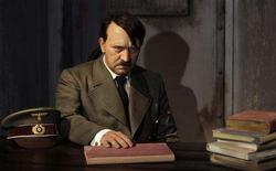 <p>A waxwork of Adolf Hitler before a 41-year-old man tore its head off from the controversial exhibit on the opening day of Berlin's Madame Tussauds July 5, 2008 is seen in this July 3, 2008 file photo. REUTERS/Tobias Schwarz/Files</p>