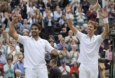 <p>Nenad Zimonjic of Serbia (L) and Daniel Nestor of Canada celebrate defeating Jonas Bjorkman of Sweden and Kevin Ullyett of Zimbabwe in their doubles finals match at the Wimbledon tennis championships in London July 5, 2008. REUTERS/Toby Melville</p>