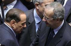 <p>Il presidente del Consiglio Silvio Berlusconi (a sinistra) e il segretario del Pd Walter Veltroni in Parlamento. REUTERS/Max Rossi (ITALY)</p>