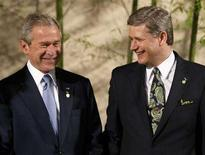<p>U.S. President George W. Bush (L) shares a laugh with Prime Minister Stephen Harper at a Tanabata ceremony during the G8 Summit at The Windsor Hotel Toya Resort and Spa in Toyako, Japan, July 7, 2008. REUTERS/Jim Young</p>