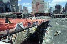 """<p>Firemen walk on a construction ramp at the former site of the World Trade Center known as """"ground zero"""" in New York on April 26, 2002. REUTERS/Peter Morgan</p>"""