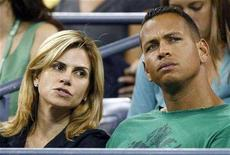 <p>New York Yankees third baseman Alex Rodriguez (R) watches an evening tennis match with his wife Cynthia (L) at the U.S. Open in Flushing Meadows, New York, September 1, 2007. REUTERS/Ray Stubblebine</p>