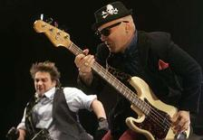 <p>Bassist Flavio Cianciarulo (R) and lead singer Vicentico of the Argentine band Fabulosos Cadillacs perform during their reunion show in Buenos Aires, July 1, 2008. REUTERS/Marcos Brindicci</p>