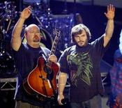 <p>Tenacious D bandmembers Kyle Gass (L) and Jack Black wave after performing 'The Pick of Destiny' at the 2006 American Music Awards on November 21, 2006 in Los Angeles. REUTERS/Mario Anzuoni</p>