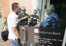 <p>A customer who did not want to give his name talks to a security officer (R) at a closed branch of IndyMac Bank in Burbank, California, July 11, 2008. Mortgage lender IndyMac Bancorp Inc was taken over by the Federal Deposit Insurance Corp on Friday, which will run the bank while it looks for a buyer. IndyMac is the second-largest financial institution in U.S. history to close. The customer and security officer were involved in a brief altercation when the customer was refused to enter into the bank, which resulted in police being called to the scene. No charges were filed. REUTERS/Fred Prouser</p>