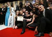 "<p>French director Laurent Cantet (R) is surrounded by students as he poses with the Palme d'Or award for his film ""Entre les Murs (The Class)"" during the award ceremony at the 61st Cannes Film Festival May 25, 2008. REUTERS/John Schults</p>"