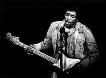 <p>This file photo shows Jimi Hendrix performing at the Gillmore East. REUTERS/COPYRIGHT AMALIE</p>
