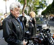 <p>Television show host Jay Leno (L) poses by his motorcycle before the beginning of a symbolic group commitment ceremony for same-sex couples in West Hollywood, California June 4, 2008. REUTERS/Mario Anzuoni</p>