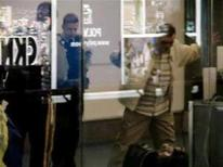 <p>Polish immigrant Robert Dziekanski (R) is seen in the arrivals area of the Vancouver airport in this video grab on October 14, 2007. REUTERS/Paul Pritchard/Handout</p>