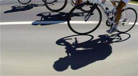 <p>Shadows are cast on the road as the pack of riders cycle during the thirteenth stage of the 95th Tour de France cycling race between Narbonne and Nimes, July 18, 2008. REUTERS/Bogdan Cristel</p>