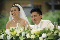 <p>Hong Kong actors Tony Leung and Carina Lau smile during their wedding ceremony in the Kingdom of Bhutan July 21, 2008. REUTERS/Handout</p>