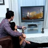 <p>People are seen watching one of BSkyB's available channels in a publicity photo. REUTERS/BSkyB/Handout</p>