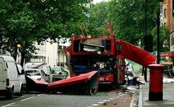 <p>The bomb destroyed number 30 double-decker bus is seen in Tavistock Square in central London July 8, 2005. REUTERS/Dylan Martinez</p>