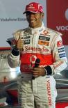 <p>Corrida noturna será desafiante, diz Hamilton. Lewis Hamilton, líder do Mundial de Fórmula 1 pela McLaren, acredita que a primeira corrida noturna de Fórmula 1, nas ruas de Cingapura, será desafiante e exigente tecnicamente. 24 de julho. Photo by Punit Paranjpe</p>