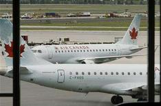 <p>Air Canada planes sit on the tarmac at Pearson International Airport in Toronto in this June 17, 2008 file photo. Air Canada aims to expand its reach to new destinations through a partnership with Continental Airlines that will put the carriers' passengers on each other's planes while maintaining their frequent flier benefits, it said on Thursday.REUTERS/Mike Cassese</p>