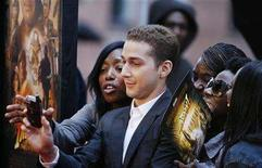 "<p>Shia LaBeouf signs autographs as he arrives for a screening of the film ""Indiana Jones and the Kingdom of the Crystal Skull"" by director Steven Spielberg in New York May 20, 2008. REUTERS/Lucas Jackson</p>"