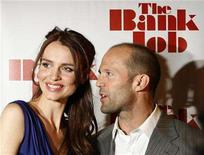 "<p>Actor Jason Statham (R) and actress Saffron Burrows arrive for a screening of the film ""The Bank Job"" in New York March 3, 2008. REUTERS/Lucas Jackson</p>"